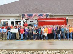 Employees present a check to Streator FD